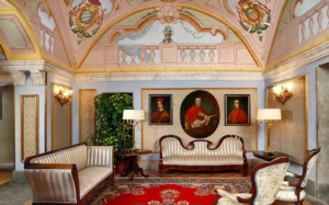 20 Luxury Wedding Venues in Italy Grand Hotel Cocumella lavish interiors with red rug and wall paintings