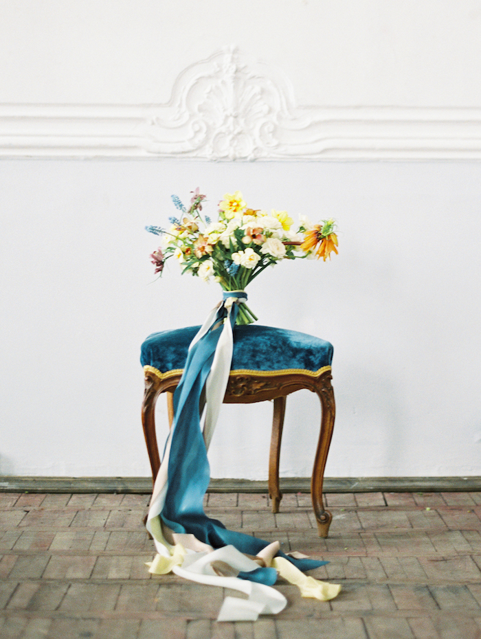 Fine Art Wedding Inspiration with a blue velvet stool and yellow flowers