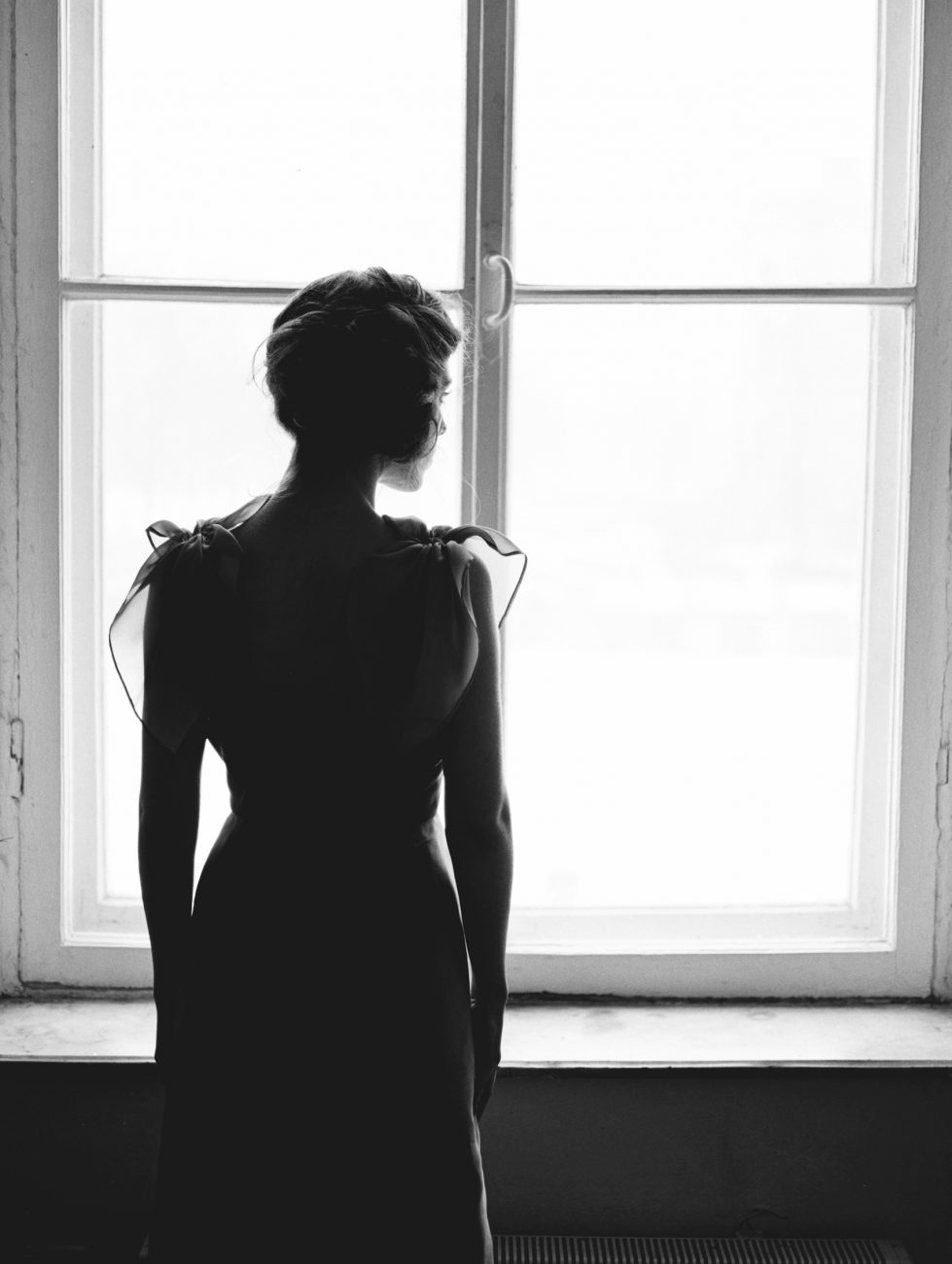 Fine Art Wedding Inspiration with black and white photo of bride looking out of the window
