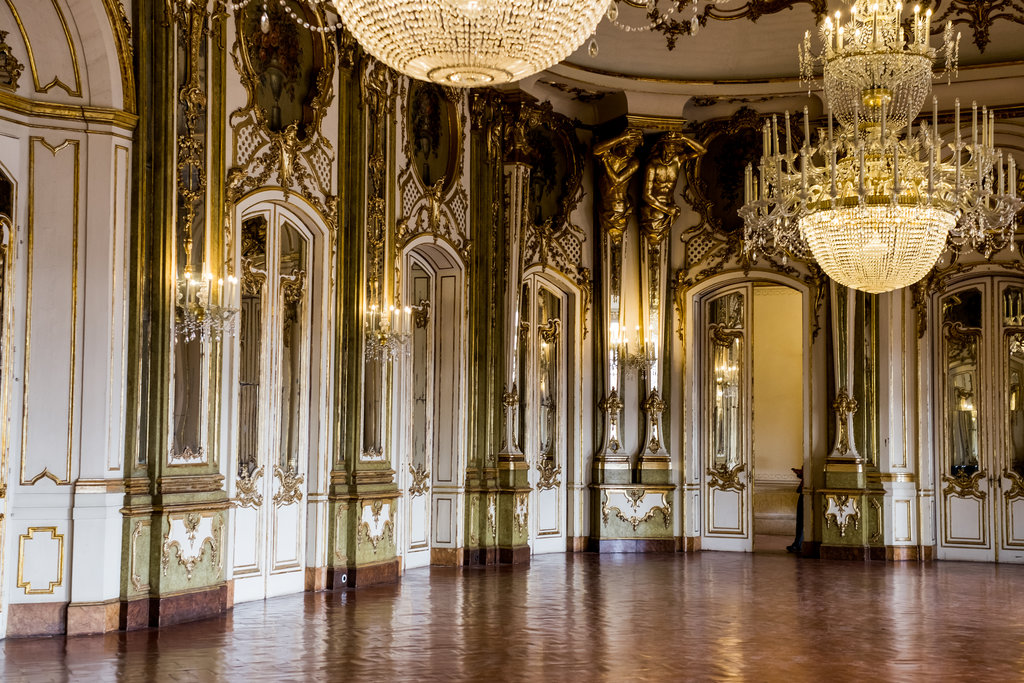 Wedding Invitation Timeline drawing influence from luxury wedding venue's gold interiors in a Portuguese Palace