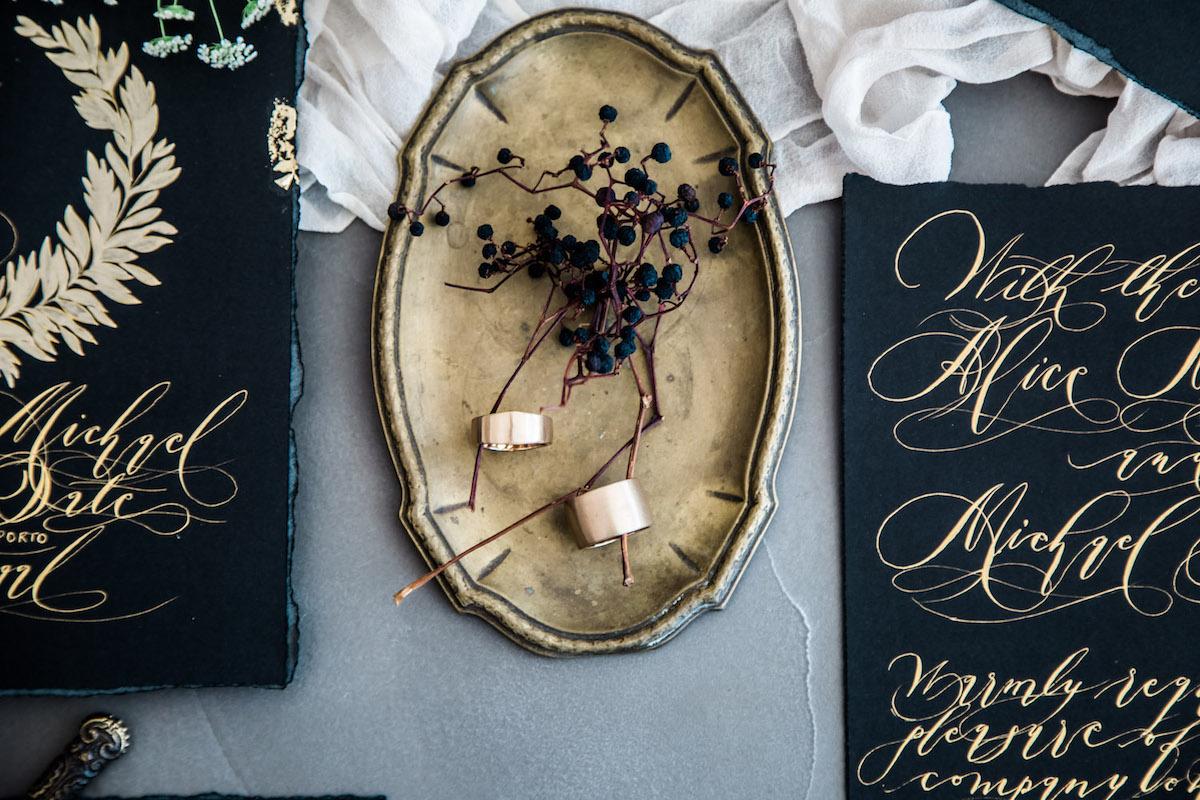 Wedding Invitation Timeline showing black and gold wedding invitations