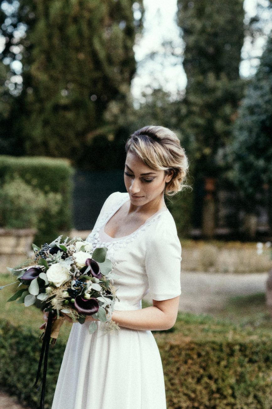 Style Shoot in Tuscany, Italy bride in garden with flowers