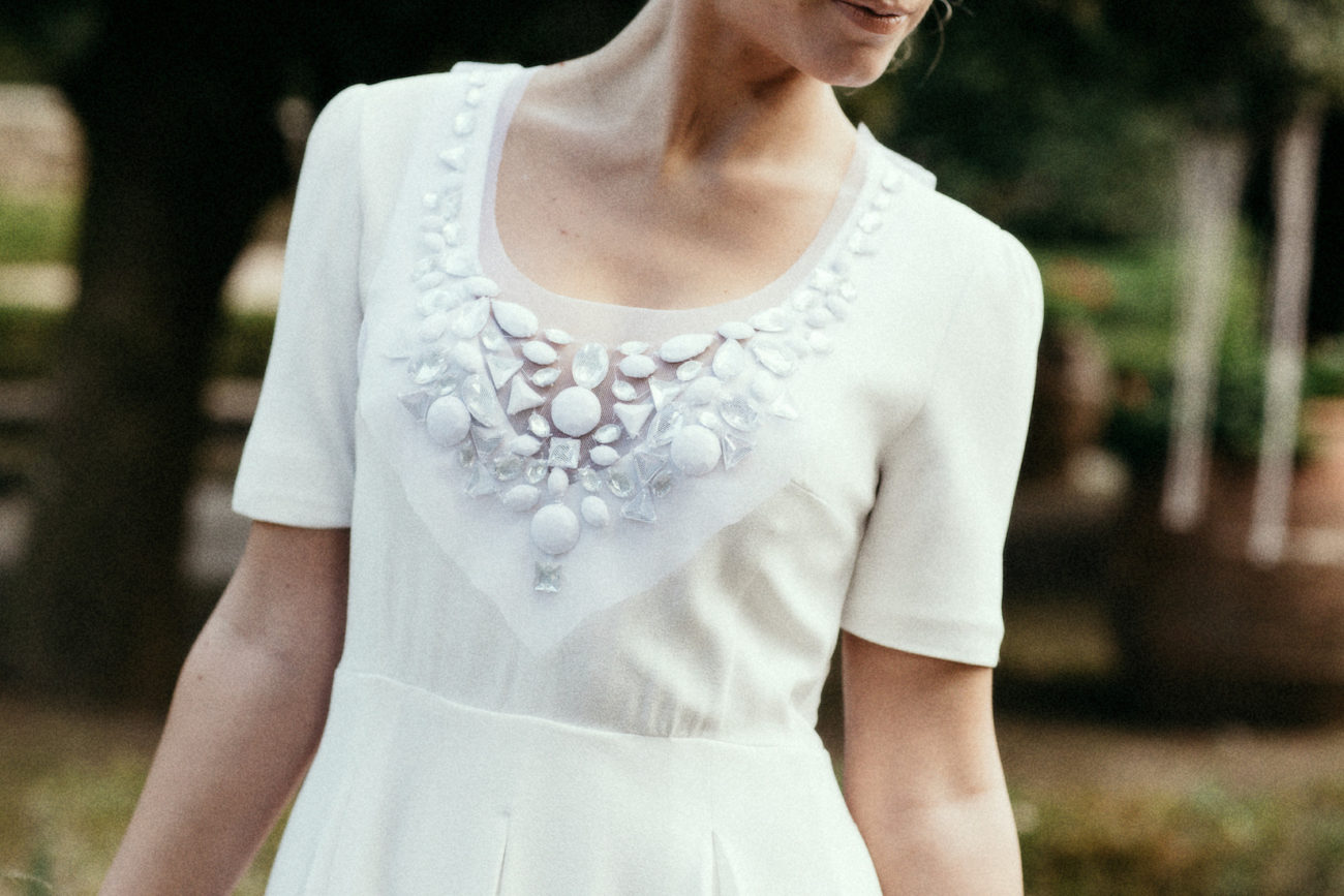 Style Shoot in Tuscany, Italy bride in wedding dress with beading detail.