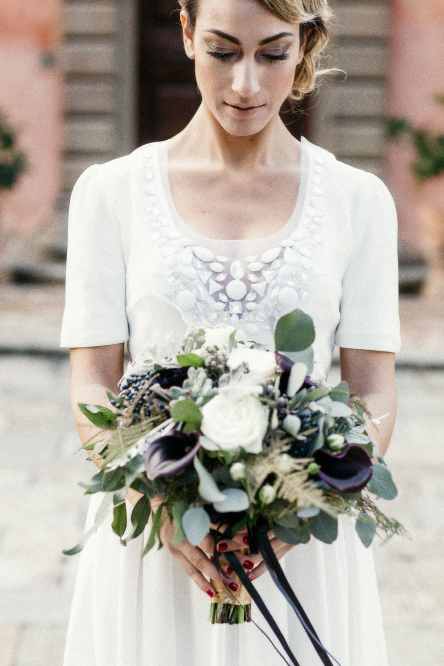 Style Shoot in Tuscany, Italy bride with dark flowers