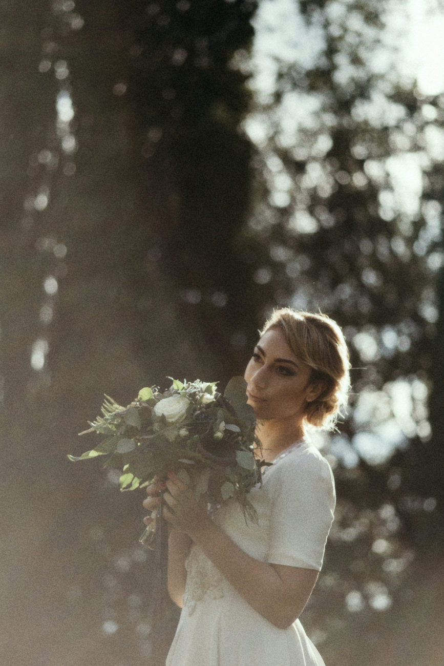 Style Shoot in Tuscany, Italy bride with flowers in the garden