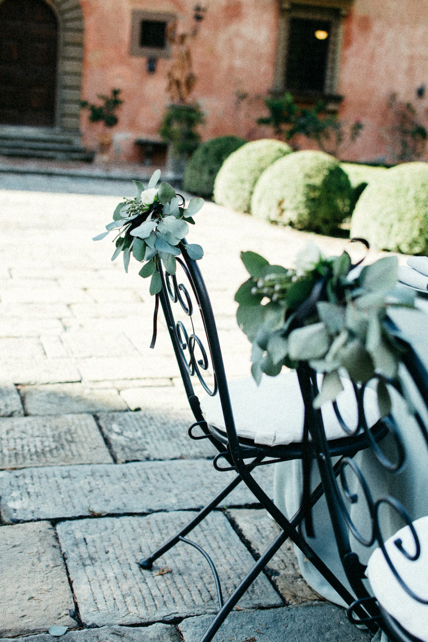 Style Shoot in Tuscany, Italy wedding chair idea with leaves