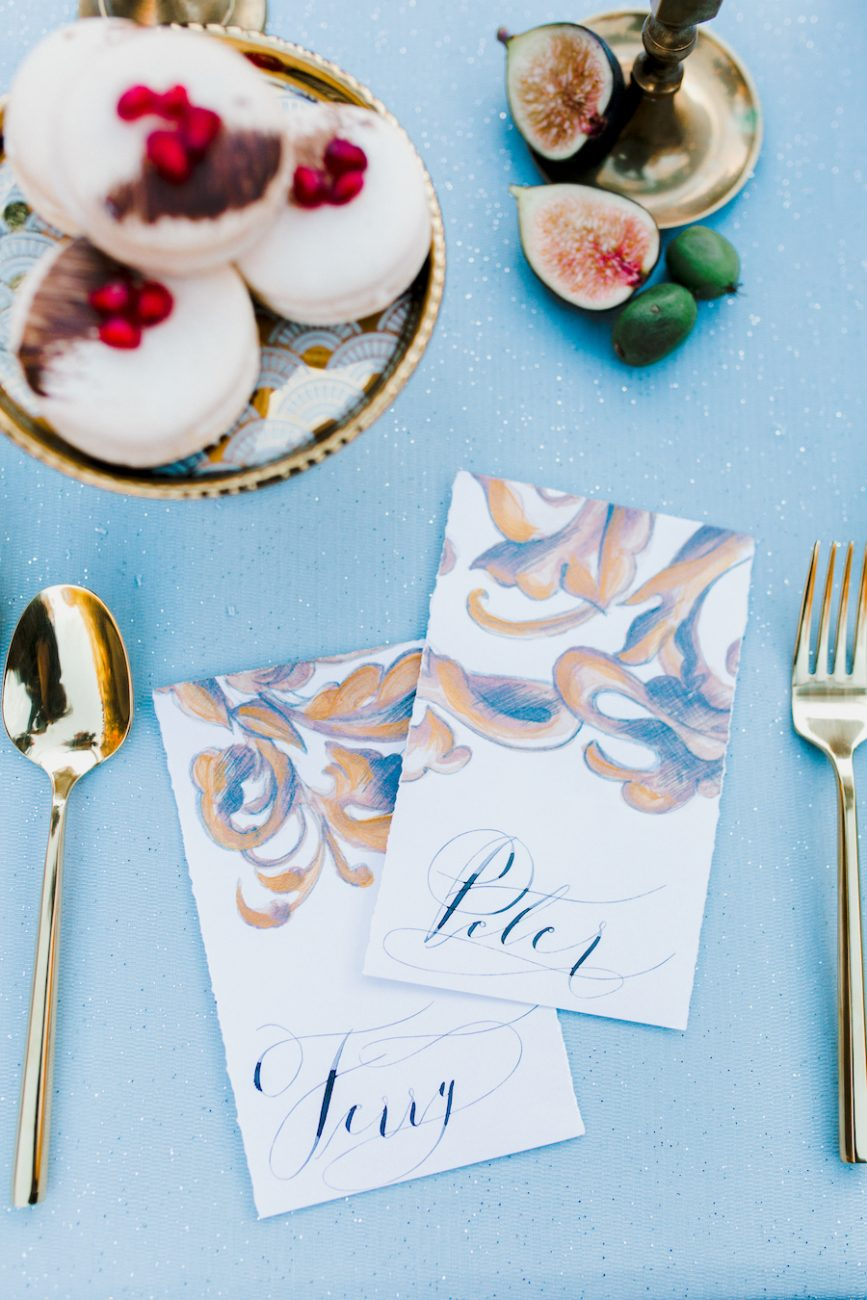 Custom Hand Painted Invitations place names with large gold design and black calligraphy