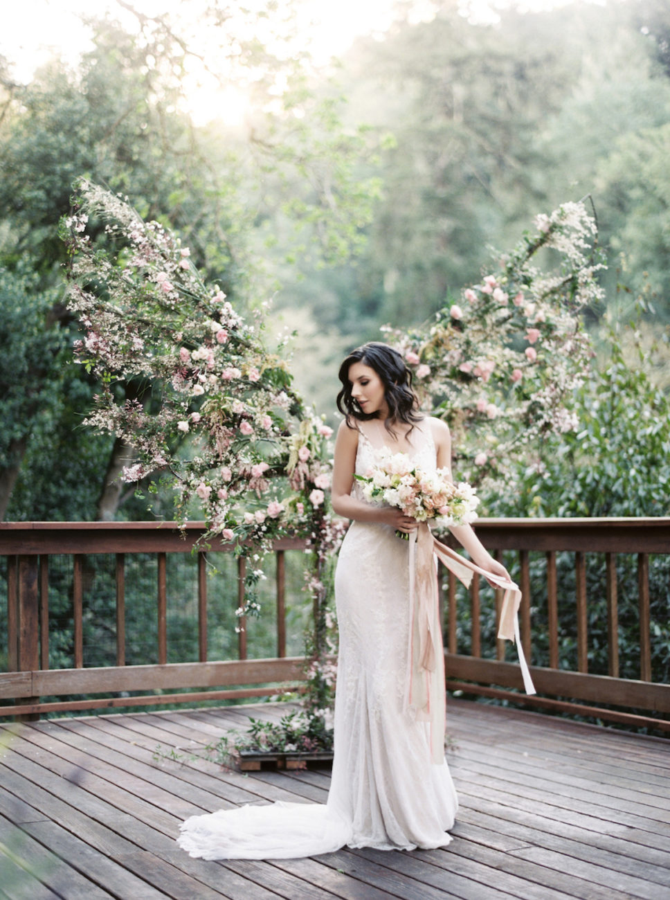 Neutral Wedding Inspiration_bride holding bouquet with ribbons