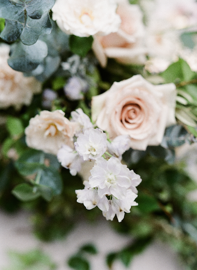 European wedding inspiration close up view of small white flowers european wedding inspiration close up view of small white flowers and peach roses mightylinksfo