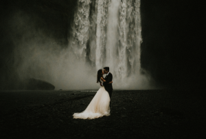 Best Destination Wedding Locations Iceland waterfall couple kissing