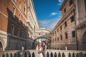 Best Destination Wedding Locations Venice bride and groom on bridge