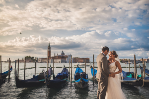 Best Destination Wedding Venice couple next to the boats