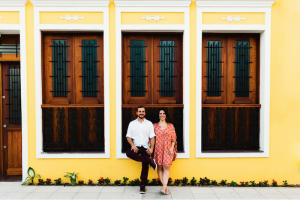 Destination Wedding Locations Brazil couple standing outside bright yellow building