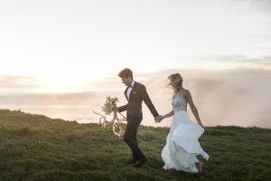 Destination Wedding Locations fog behind bride and groom