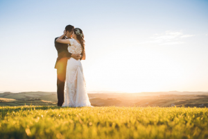 Destination Wedding Locations in Tuscany bride and groom in the sunset