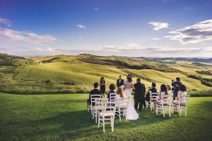 Destination Wedding Locations in Tuscany large green field with seating area