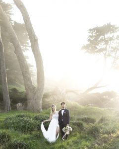 Destination Wedding Locations large trees behind couple