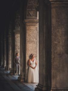 Best Destination Wedding Venice couple in building