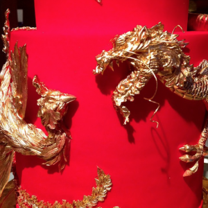 luxury wedding cake designers Chinese gold dragons on a red cake