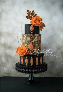 luxury wedding cake designers black and orange cake with baroque details