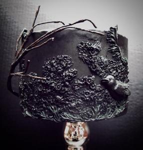 luxury wedding cake designers black cake with bird and black flowers