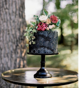 luxury wedding cake designers black cake with textures and patterns