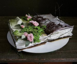 luxury wedding cake designers book with green moss and roses