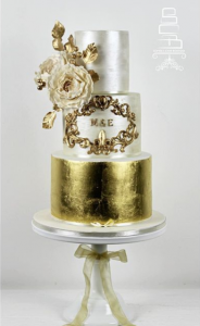 luxury wedding cake designers bright gold flowers and paint