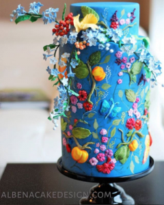 luxury wedding cake designers bright small flowers on a blue cake
