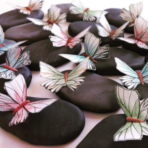 luxury wedding cake designers butterflies on pebbles