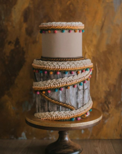 luxury-wedding-cake-designers-cable-knit-icing-border-with-little-tassles