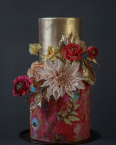 luxury wedding cake designers gold and dull red with hand painted flowers