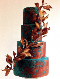 luxury wedding cake designers metallic brown and deep blue marbled cake with brown leaves