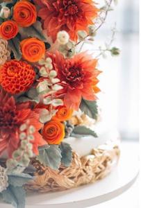 luxury wedding cake designers orange flowers