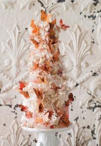 luxury wedding cake designers orange and white butterflies
