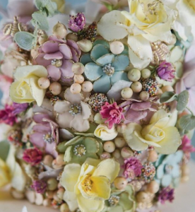 luxury wedding cake designers small pastel coloured sugar flowers and tiny balls