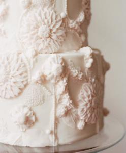 luxury wedding cake designers softly shaped large cream flowers