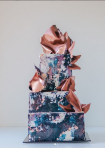 luxury wedding cake designers textured blue and copper icing