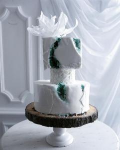 luxury wedding cake designers white and green rocks