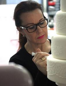 5 wedding cake designers mel icing a cake