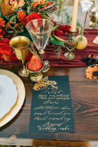 Rich Red & Gold Autumn Wedding black and gold calligraphy wedding menu with gold cups and crystal glasses