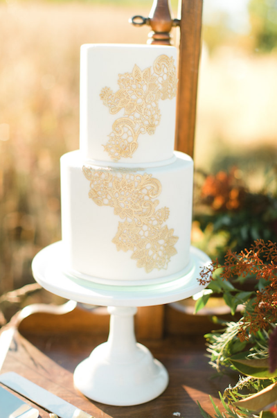 Rich Red Gold Autumn White Wedding Cake With Gold Lace Icing