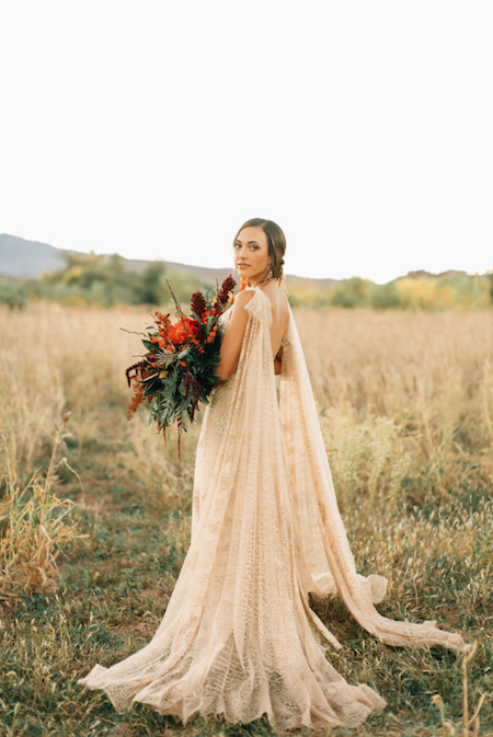Thankful For Love bride with gold dress side stance