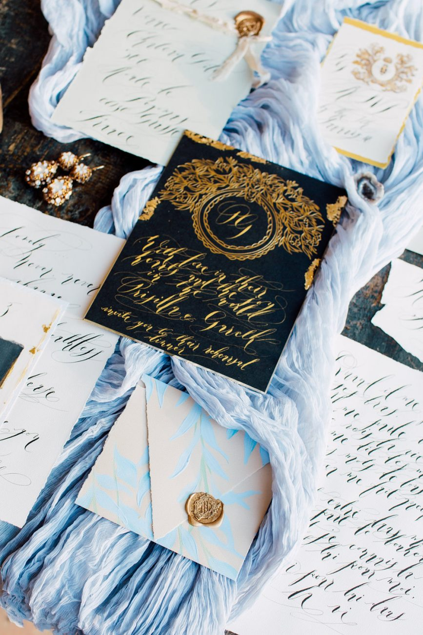 French Wedding Inspiration black wedding invitation with blue envelope
