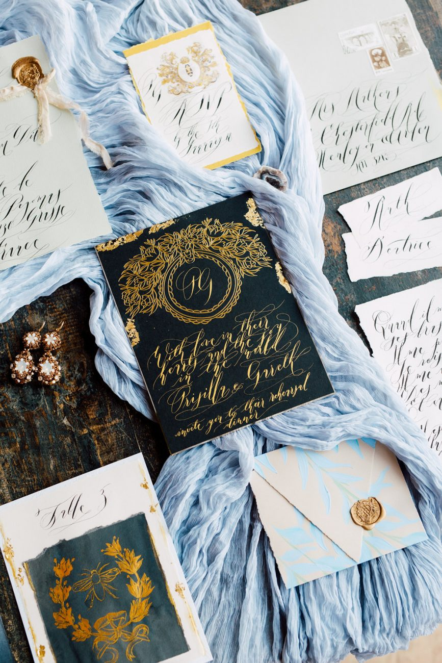 French Wedding Inspiration black wedding stationery with gold foil with envelope