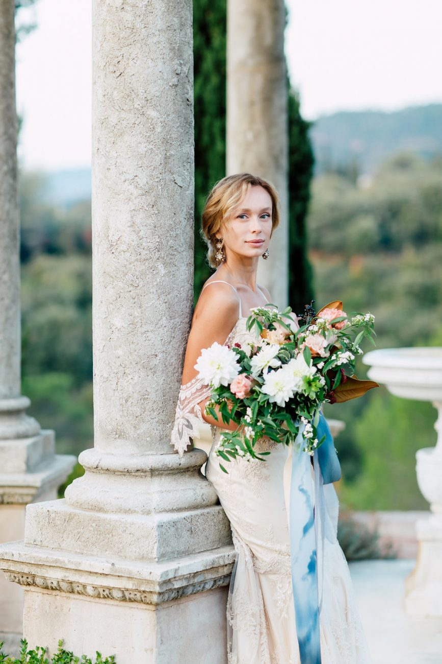 French Wedding Inspiration bride leaning against column