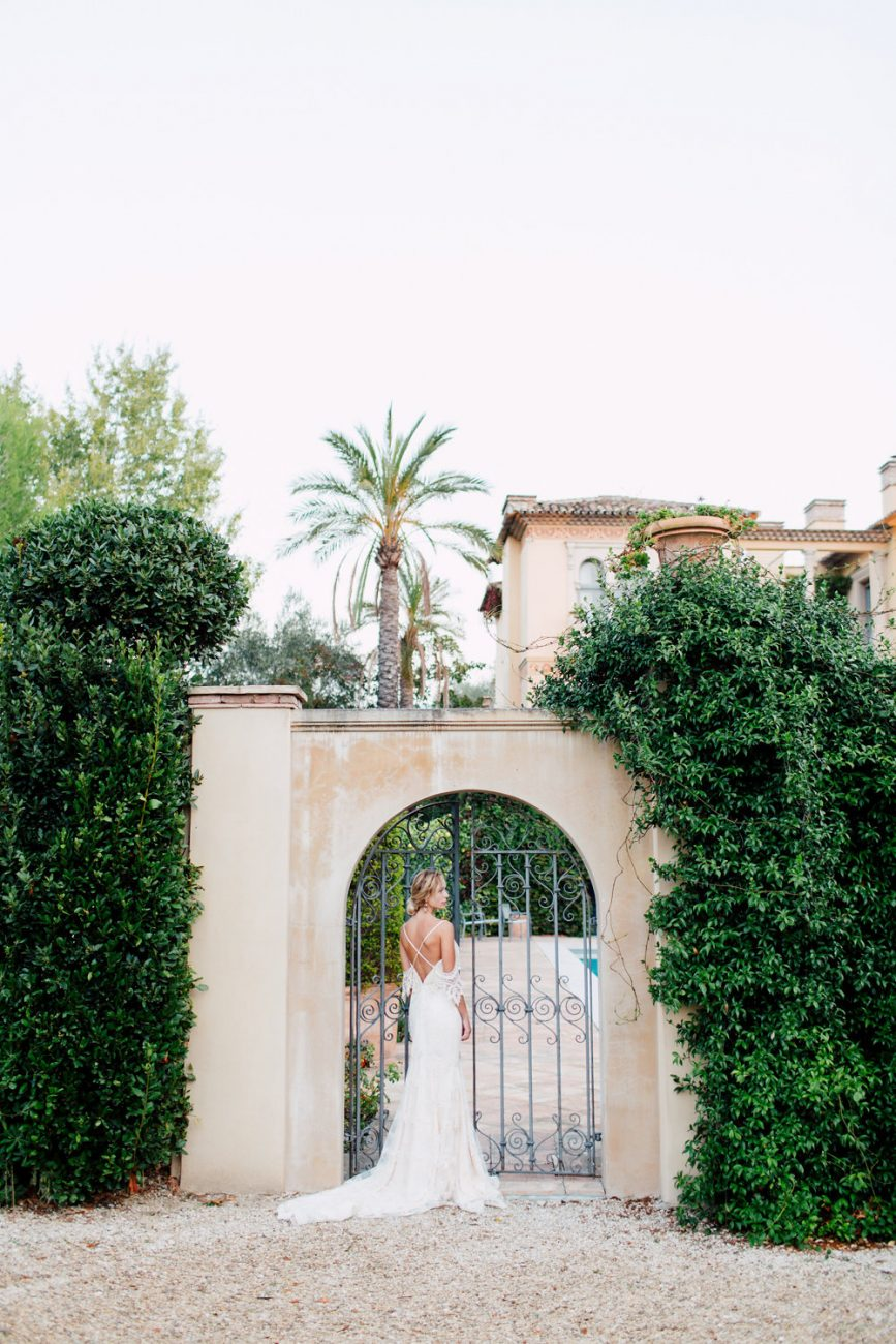 French Wedding Inspiration bride opening gates