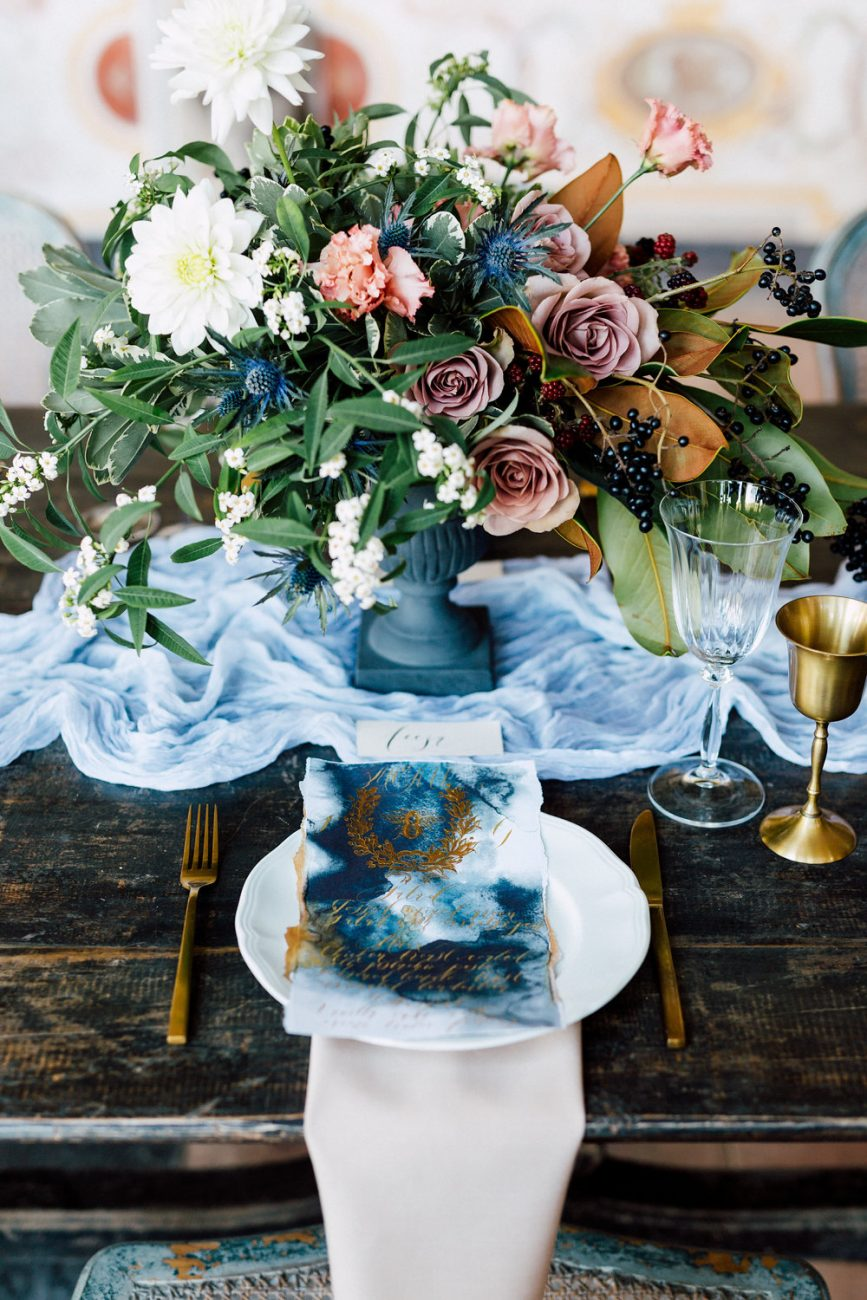 French Wedding Inspiration table setting with flowers and menu