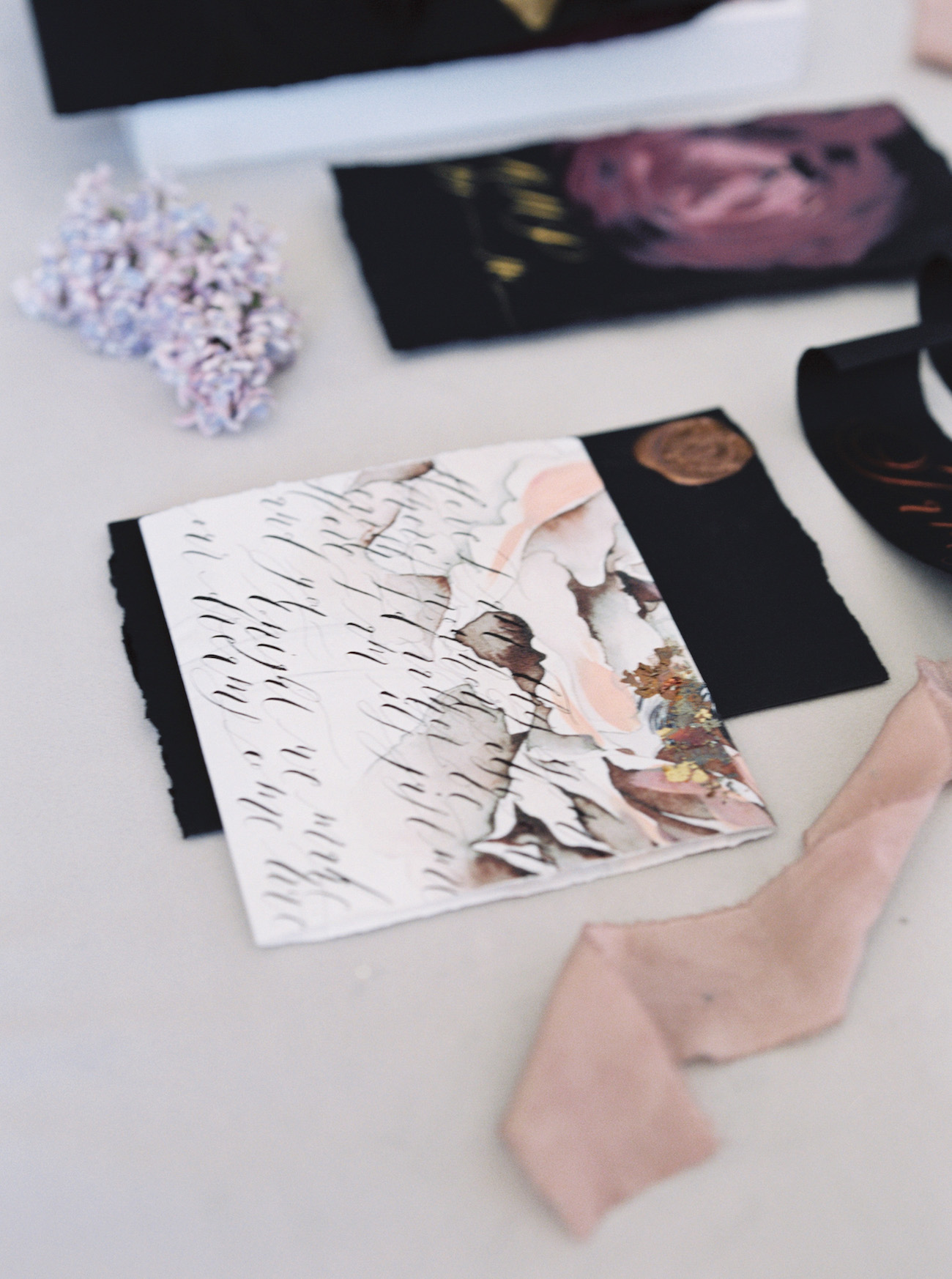 Latest Wedding invitation trends for 2019 - white and blush Invitation wrap with black calligraphy