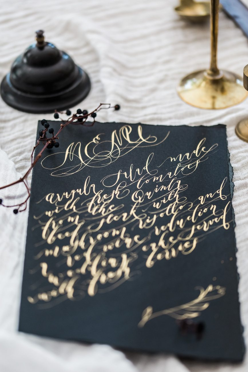 Fine Art Black Tie Wedding Inspiration Shoot black wedding menu with gold calligraphy